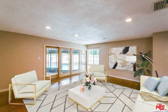 2424 Candlewood Street, Lakewood, CA 90712 (#21759522) :: Doherty Real Estate Group
