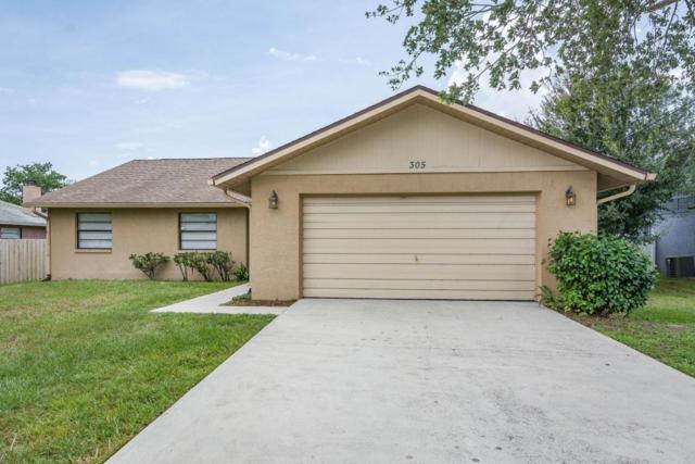 305 Woods Lake Drive, Cocoa, FL 32926 (MLS #819774) :: Premium Properties Real Estate Services