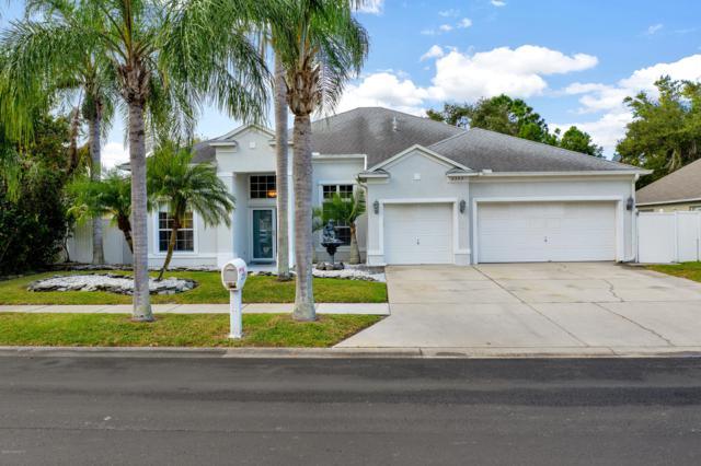 2355 NE Summer Brook Street, Melbourne, FL 32940 (MLS #829976) :: Platinum Group / Keller Williams Realty