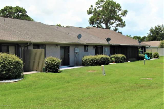 1613 NE Club Gardens Drive NE #1613, Palm Bay, FL 32905 (MLS #848293) :: Premium Properties Real Estate Services