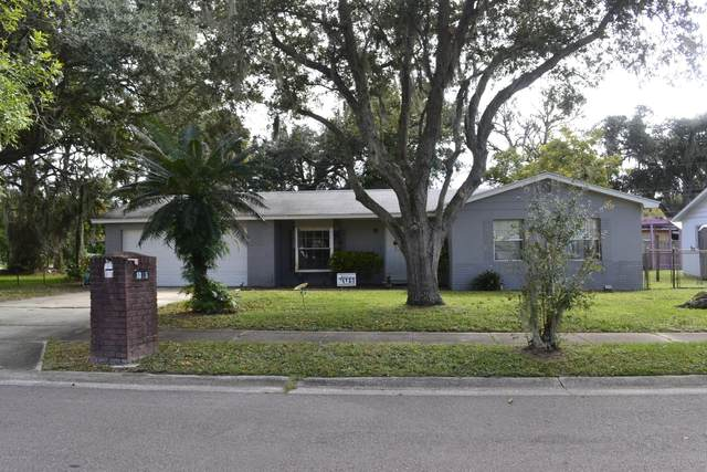 1035 Country Club Boulevard, Titusville, FL 32780 (MLS #888741) :: Premium Properties Real Estate Services