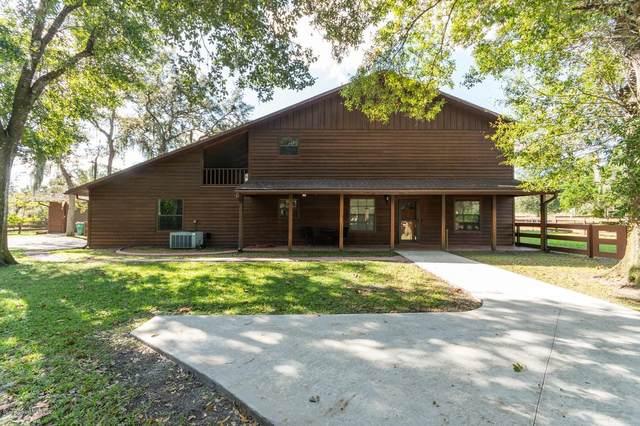 1360 War Eagle Boulevard, Titusville, FL 32796 (MLS #890957) :: Coldwell Banker Realty