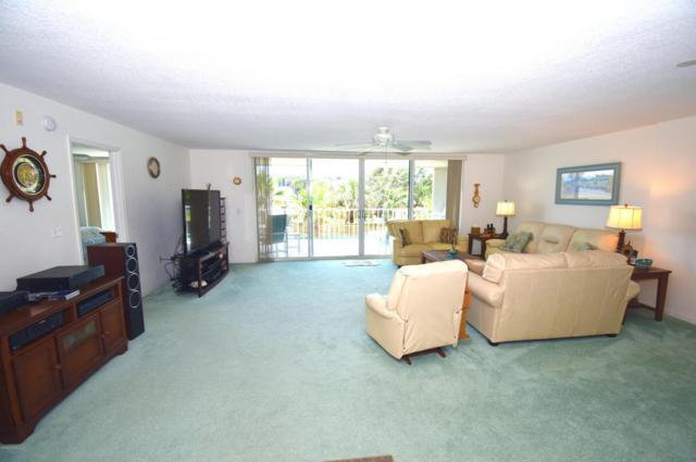 3400 Ocean Beach Boulevard #214, Cocoa Beach, FL 32931 (MLS #810518) :: Premium Properties Real Estate Services