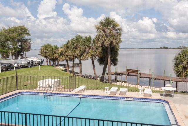 3833 S Banana River Boulevard #202, Cocoa Beach, FL 32931 (MLS #818304) :: Platinum Group / Keller Williams Realty