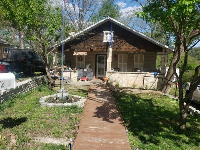210 Garden  Avenue, Rockaway Beach, MO 65740 (MLS #60188429) :: Team Real Estate - Springfield