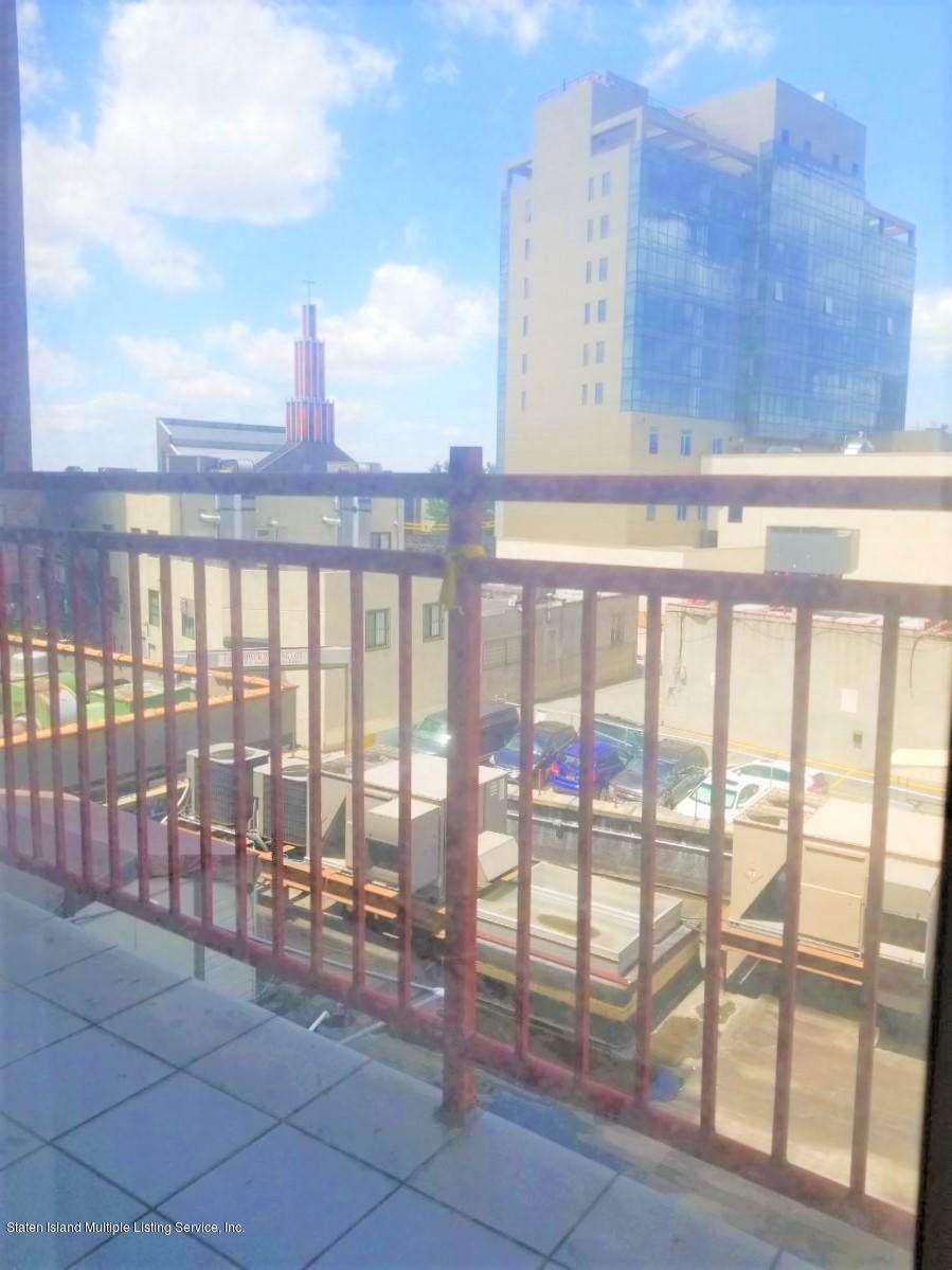135-37 37th Avenue - Photo 1