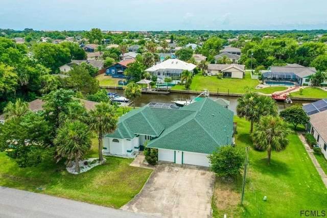143 N Coral Reef Court, Palm Coast, FL 32137 (MLS #214450) :: Bridge City Real Estate Co.