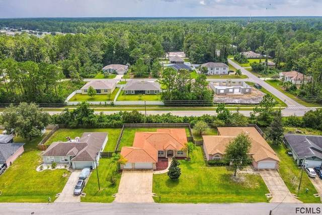 52 Russell Drive, Palm Coast, FL 32164 (MLS #216969) :: The Perfect Place Team