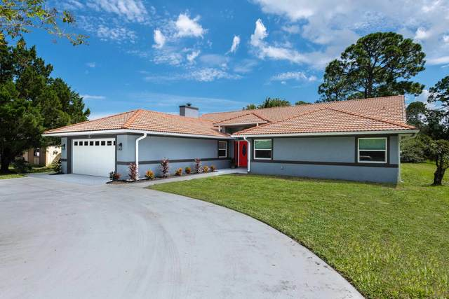55 Forest Hill Dr, Palm Coast, FL 32137 (MLS #217146) :: The Collective at Momentum Realty