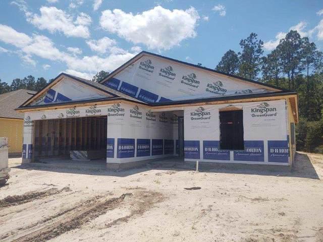 68 Oakleaf Way, Palm Coast, FL 32110 (MLS #212785) :: Century 21 St Augustine Properties