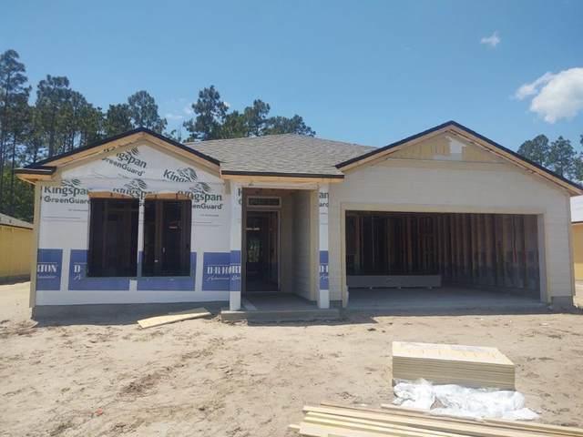 74 Oakleaf Way, Palm Coast, FL 32110 (MLS #212787) :: Century 21 St Augustine Properties