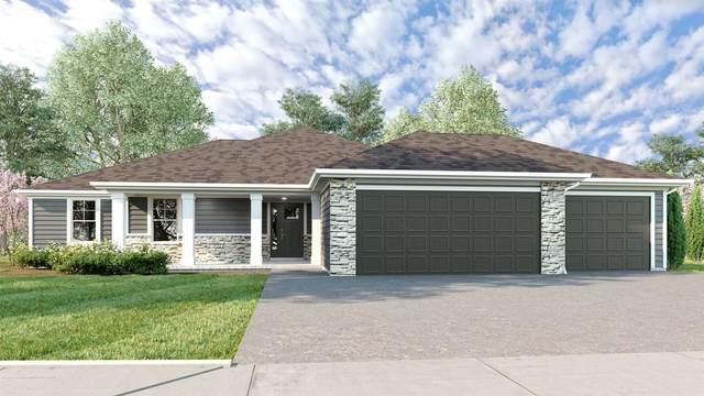 2306 NW 49th Ter, Topeka, KS 66618 (MLS #220311) :: Stone & Story Real Estate Group