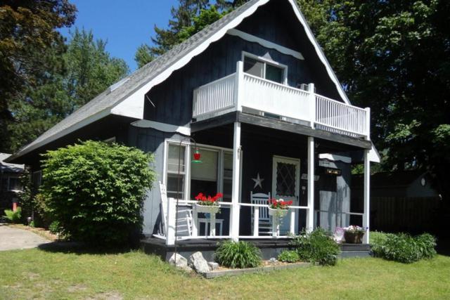 5190 Main Street, Onekama, MI 49675 (MLS #17052105) :: Carlson Realtors & Development