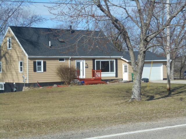8435 Hanna Lake Avenue SE, Caledonia, MI 49316 (MLS #18010418) :: JH Realty Partners