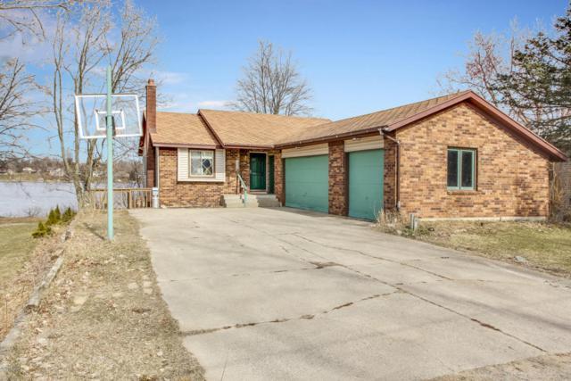 8113 Cowan Lake Drive NE, Rockford, MI 49341 (MLS #18010804) :: JH Realty Partners