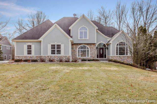 2300 Cascade Lakes Circle, Grand Rapids, MI 49546 (MLS #18010908) :: JH Realty Partners