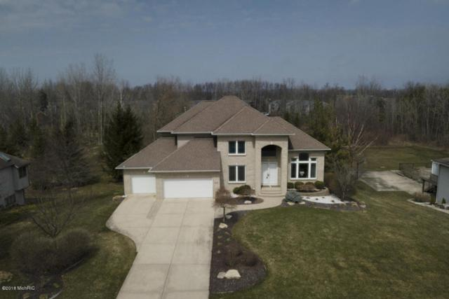 91 Stonehenge Drive SW, Grandville, MI 49418 (MLS #18014620) :: 42 North Realty Group