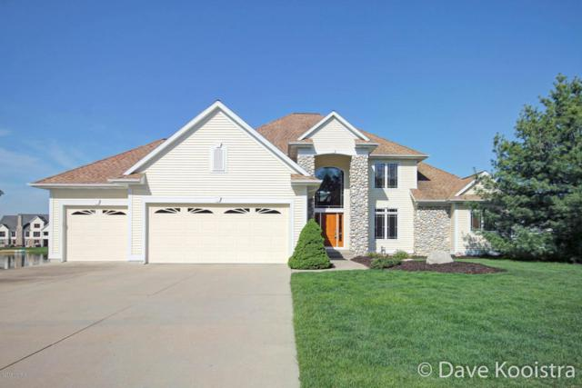 3588 Big Rock Court SW, Grandville, MI 49418 (MLS #18021554) :: Deb Stevenson Group - Greenridge Realty