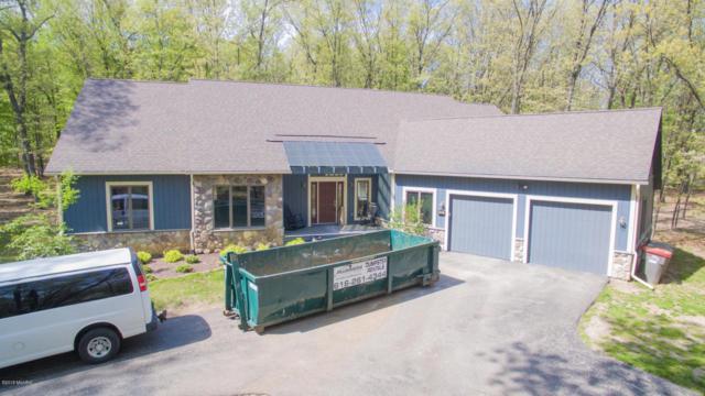 8727 SE Conservancy Drive, Ada, MI 49301 (MLS #18021755) :: Deb Stevenson Group - Greenridge Realty