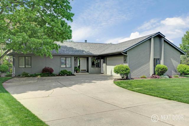 5073 N Oakvale Court SW, Wyoming, MI 49519 (MLS #18021859) :: Deb Stevenson Group - Greenridge Realty