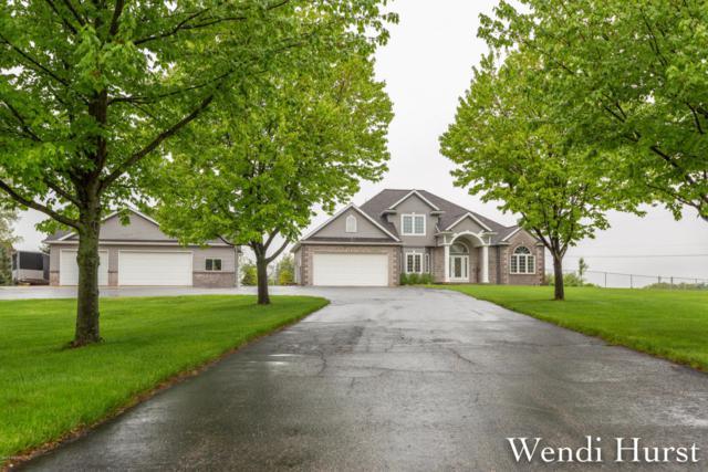 12225 Pine Island Drive, Sparta, MI 49345 (MLS #18022006) :: Deb Stevenson Group - Greenridge Realty
