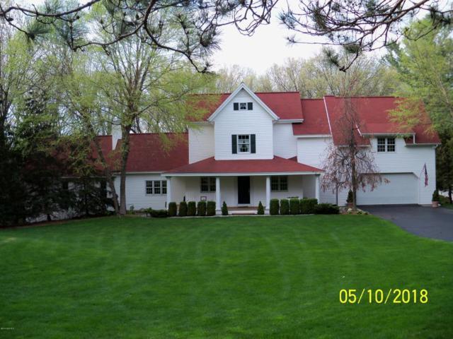 7750 Cascade Road SE, Grand Rapids, MI 49546 (MLS #18022092) :: Deb Stevenson Group - Greenridge Realty