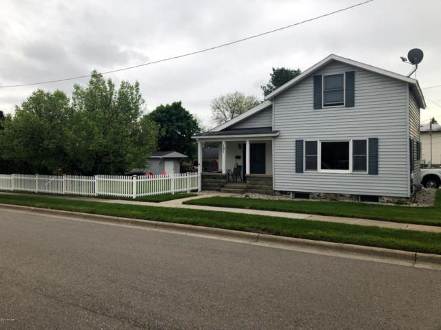 121 N Jackson Street SE, Lowell, MI 49331 (MLS #18022146) :: Deb Stevenson Group - Greenridge Realty