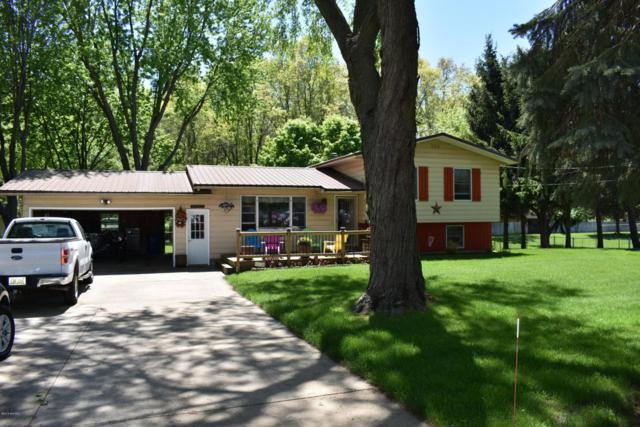 15848 Comstock Street, Grand Haven, MI 49417 (MLS #18023104) :: Deb Stevenson Group - Greenridge Realty
