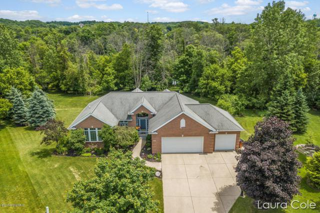 62 Chelsea Court, Rockford, MI 49341 (MLS #18027064) :: 42 North Realty Group