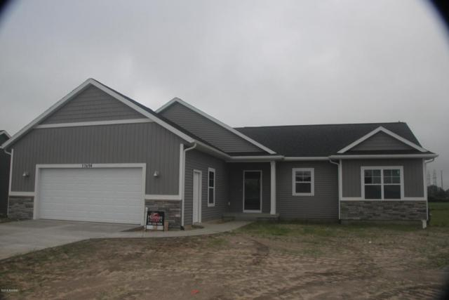 11694 Olive Lake Court, West Olive, MI 49460 (MLS #18029652) :: 42 North Realty Group
