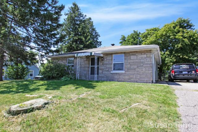 4011 Childs Avenue NW, Comstock Park, MI 49321 (MLS #18032166) :: Matt Mulder Home Selling Team