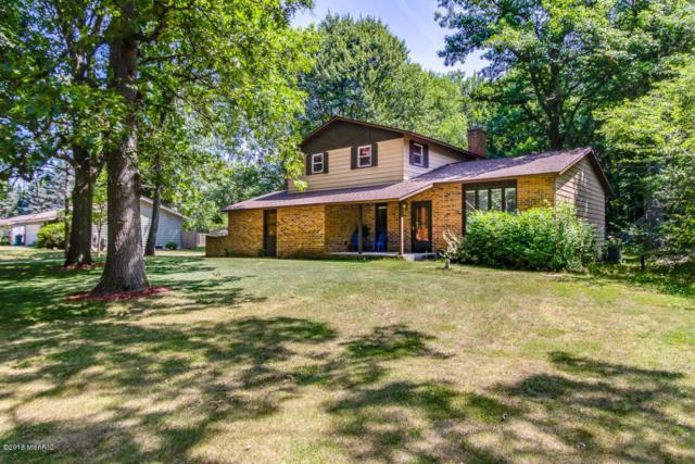 11616 Woodgate Drive NW, Grand Rapids, MI 49534 (MLS #18032886) :: Carlson Realtors & Development