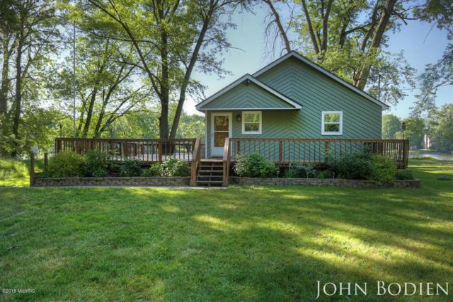 4450 Abrigador Trail NE, Comstock Park, MI 49321 (MLS #18033151) :: Matt Mulder Home Selling Team