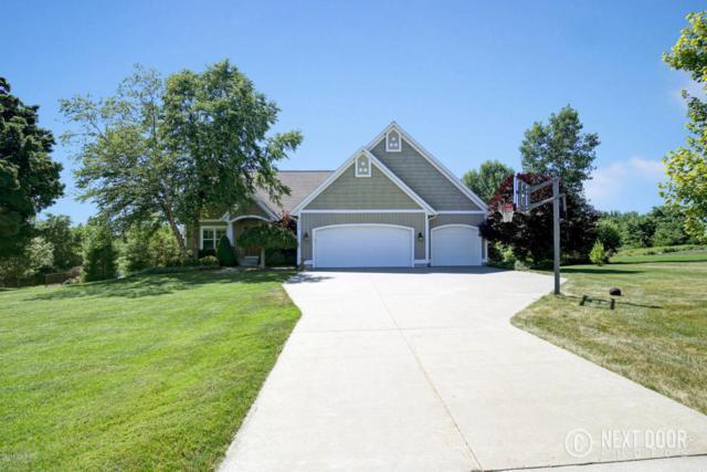 4233 Samantha NW, Grand Rapids, MI 49544 (MLS #18034390) :: Carlson Realtors & Development