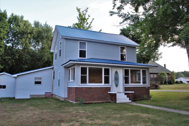 127 W Bridge Street, Six Lakes, MI 48886 (MLS #18038248) :: Deb Stevenson Group - Greenridge Realty