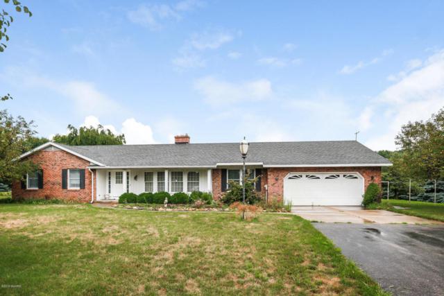 9023 5 Mile Road NE, Ada, MI 49301 (MLS #18039863) :: Carlson Realtors & Development