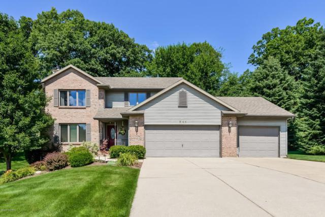 711 Pendleton Drive NE, Comstock Park, MI 49321 (MLS #18039907) :: Matt Mulder Home Selling Team