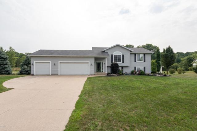 7522 Bostwick Lake View Drive, Rockford, MI 49341 (MLS #18040216) :: Carlson Realtors & Development