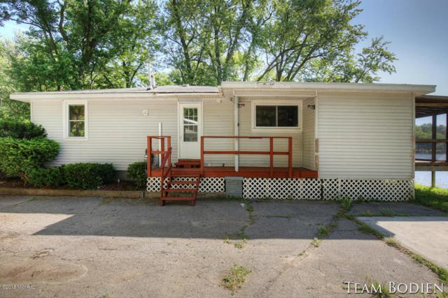4442 Abrigador Trail NE, Comstock Park, MI 49321 (MLS #18040261) :: Matt Mulder Home Selling Team