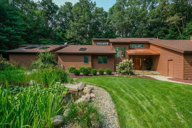7156 Glade Trail, Kalamazoo, MI 49009 (MLS #18040506) :: Matt Mulder Home Selling Team