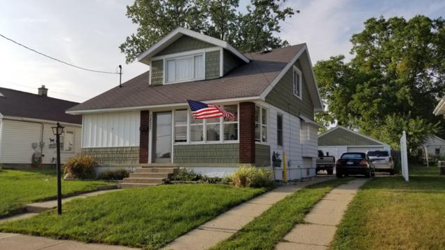 3827 White Street SW, Grandville, MI 49418 (MLS #18042548) :: Carlson Realtors & Development