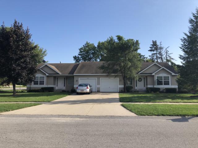 1580 Maple Hollow Street SE, Kentwood, MI 49508 (MLS #18046238) :: JH Realty Partners