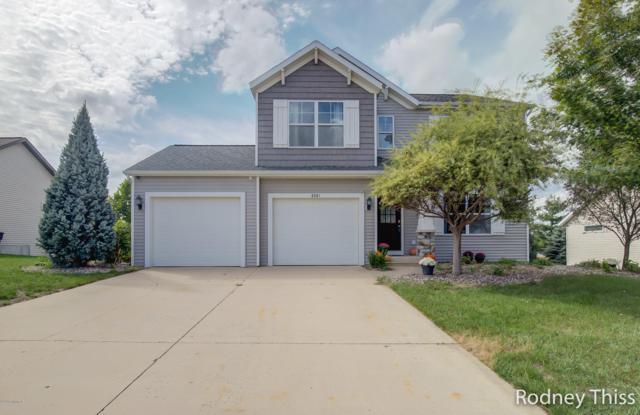 6561 Bradenwood Drive, Hudsonville, MI 49426 (MLS #18047411) :: Deb Stevenson Group - Greenridge Realty