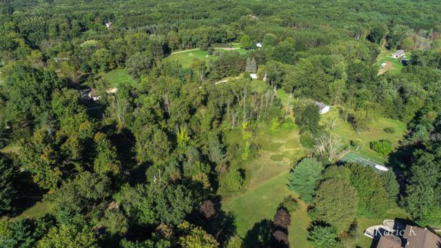 920 Cramton Avenue NE, Ada, MI 49301 (MLS #18047556) :: Deb Stevenson Group - Greenridge Realty