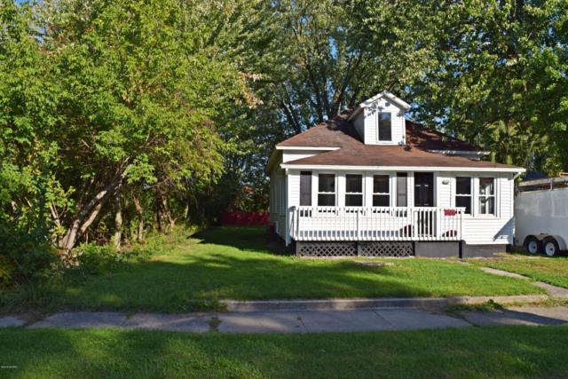 108 N Gay Street, Scottville, MI 49454 (MLS #18048266) :: Deb Stevenson Group - Greenridge Realty
