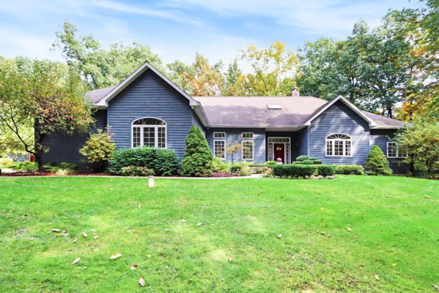 7180 Fox Meadow Drive NE, Rockford, MI 49341 (MLS #18049810) :: JH Realty Partners