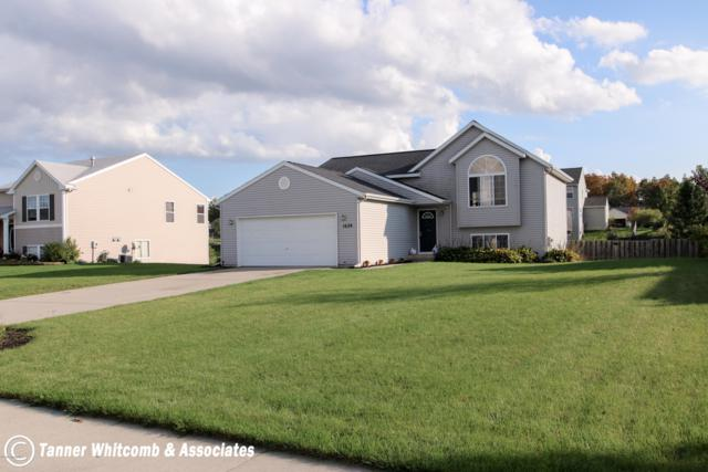 1628 South Park Drive SE, Caledonia, MI 49316 (MLS #18049998) :: Deb Stevenson Group - Greenridge Realty