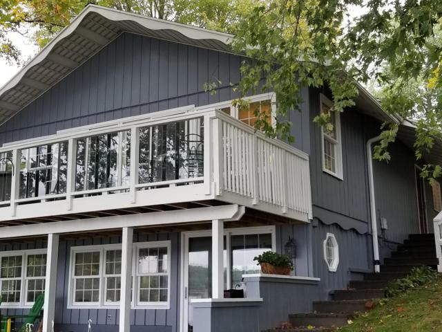 7765 W Lake Drive, Canadian Lakes, MI 49346 (MLS #18050499) :: Deb Stevenson Group - Greenridge Realty