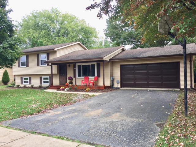 5627 Grand Traverse Lane, Portage, MI 49024 (MLS #18050694) :: Carlson Realtors & Development