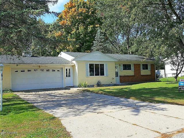 5051 Biddeford Drive NW, Comstock Park, MI 49321 (MLS #18050793) :: Matt Mulder Home Selling Team